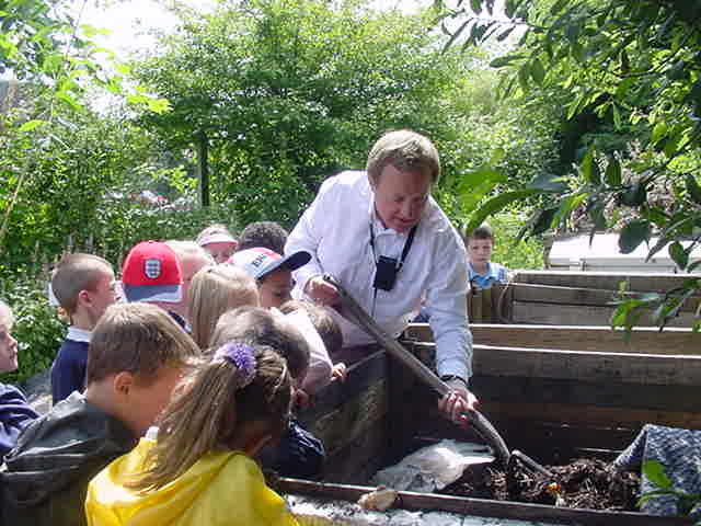 Mark showing Hillborne schoolchildren wildlife in the compost bins