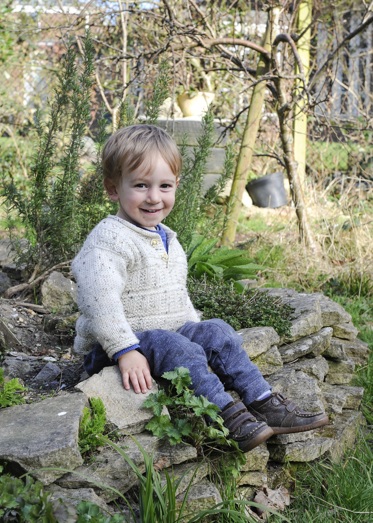 wee Mateo in the herb bed